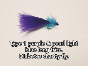 Type 1 Purple & Pearl Light Blue Long Straggle Fritz. (Charity Fly)
